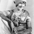 Woman in a cloche hat and satin dress looking vivacious — ストック写真