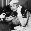 Stock Photo: Young womin sailors uniform on telephone