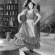 Young woman with a buccaneer hat dancing on a chair — Stok fotoğraf