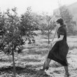 Young woman in a garden doing gardening — Stok fotoğraf