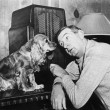 Man and dog listening to the radio - Stock Photo