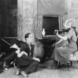 Woman playing the violin for her boyfriend and dog — Stockfoto
