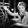 Young woman working as a telephone operator - Stockfoto