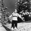 Young woman standing on a hill in snow - Foto de Stock