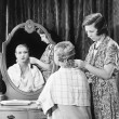One womdoing other woman's hair — Foto de stock #12298807