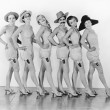 Women standing in a chorus line in lingerie — Stock Photo