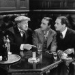Three men sitting together at a bar — Stock Photo