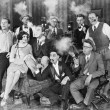 Group of sitting in a living room smoking — Foto de Stock