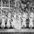 Group of dancers standing on a stage with their arms in the air and a drink in their hands — 图库照片