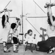 Father and his three children having a workout with dumbbells — Zdjęcie stockowe