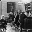 Men sitting around a counter in a bar — Stok fotoğraf
