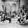 Group of sitting on oversized cushions in a hall — Stok fotoğraf