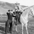 Two cowboys and white horse — Stock Photo #12299685