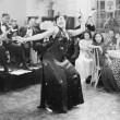 Zaftig woman performing a dance in front of a group of in a restaurant — Stock Photo