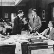 Four men at an office — Stockfoto