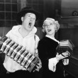 Stock Photo: Couple singing while playing two accordions