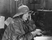 Woman in raincoat sending message in Morse code — Stok fotoğraf