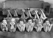 Portrait of young women in row on floor — Stockfoto