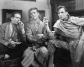 Three men smoking cigars — Stock Photo