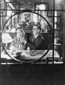 Couple through window in restaurant — Stock Photo