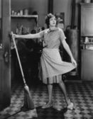 Woman with broom — Stock Photo