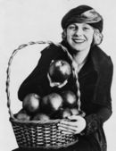 Portrait of woman with basket of apples — Stock Photo