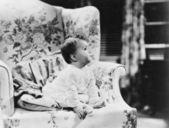 Babysitting op leunstoel — Stockfoto