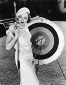 Female archer with bulls eyes — Stock Photo