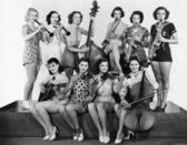 Group of young women playing instrument — Stock Photo