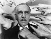 Zbliżenie wielu palców wskazujących na człowieka — Zdjęcie stockowe