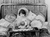 Woman having breakfast in bed — Stock Photo