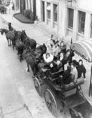 Group of women in horse drawn carriage — Stock Photo