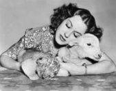 Woman with sleeping lamb and lion cub — Stock Photo