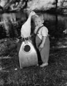 Portrait of toddler with duck — Stock Photo