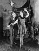 Man with ballerina en pointe — Stock Photo