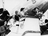 Women sending off friend boarding plane — Stock Photo