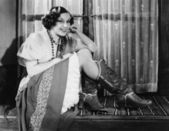 Portret kobiety sobie kowbojki — Zdjęcie stockowe