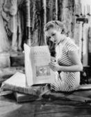 Portrait of woman reading Catholic text — Stock Photo