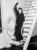 Female passenger on boat waving — Stock Photo