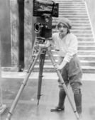 Woman operating movie camera — Stock Photo