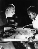 Two men playing backgammon — Stock Photo