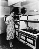 Woman with large stove — Stock Photo