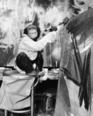Chimpanzee as an artist — Stock Photo