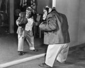 Chimpanzee in a jacket and trousers in front of a mirror — Photo