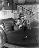 Young boy sitting in the driver's seat of car with his father — Foto Stock