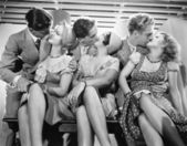 Three couples romancing and kissing — Stockfoto