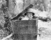 Man hiding himself in a basket — Stock Photo