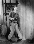 Drunken man holding a handgun — Stock Photo