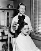 Young woman getting her hair done in a hair salon — Stock Photo