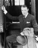 Portrait of a businessman boarding a train — Stock Photo
